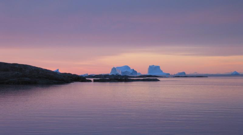Blues, yellows and mauve Sunrise with Icebergs, and Mountains