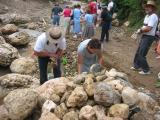 everyone is to carry 2 rocks to put in the creek so the trucks do not get stuck