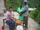 Rachel helping one of the local women shell corn