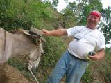 Jerry with his hat on the donkey