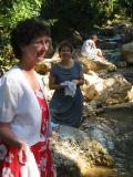 at the creek to wash up for church dedication service