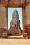 Wat Ratchaburana framed through the main gate