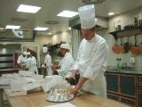 Chef pours champagne for all