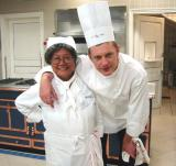 A very tall chef & a very short student