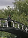 Man on a bridge in Camden Lock