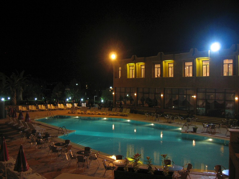 The hotel pool later that night