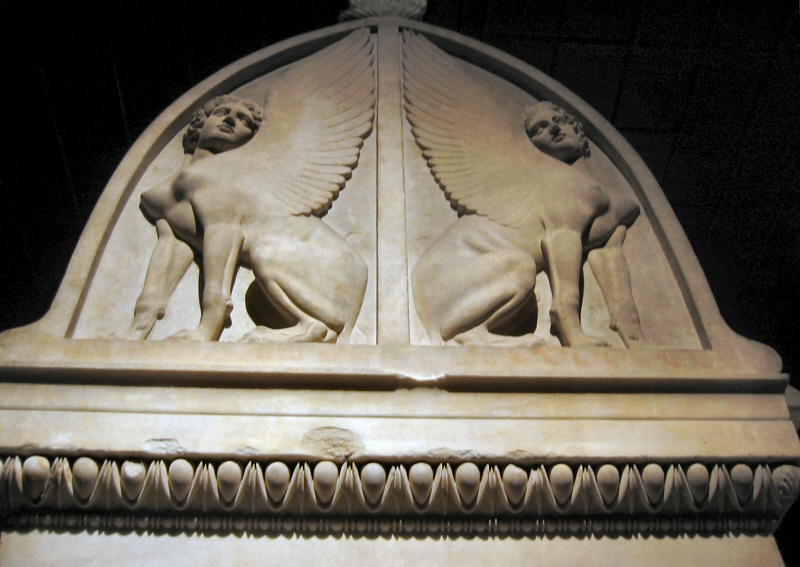 The area above, on the lid.   Very strange-looking sphinxes?