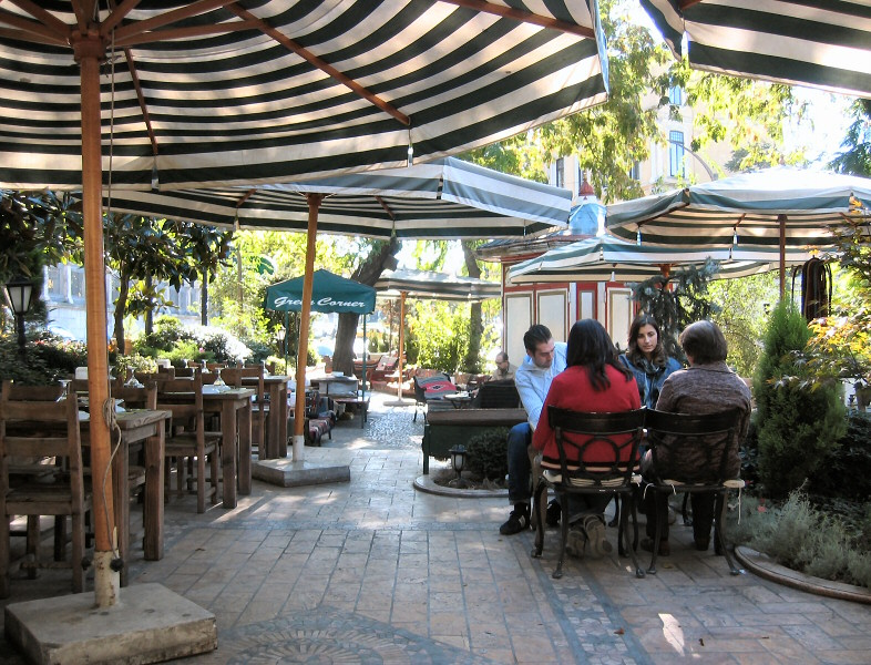 The Green Corner cafe - table at right was<br>overturned later by a thief running from pursuers.