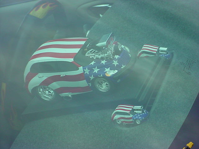 red white and blue <br> PT Cruiser in the window
