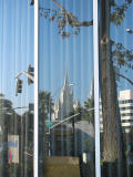 Reflection in Bank of America Window by Emese Gaal