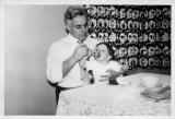 Dad feeding Mary, 1950 (271)