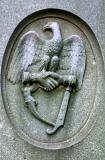 Grave Marker Detail - Dropping Swords and Shaking Hands