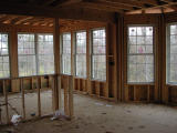 From the kitchen looking through to the sunroom - windows everywhere