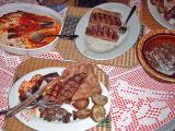 steaks served with eggplant parmesan, sauteed mushrooms, pan roasted potatoes