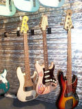 A master built relic P Bass, a strat carved by George Amicay and a J Bass