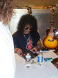 Slash signing autographs in the Guild booth