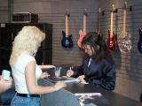 Michael Wilton of Queensryche signing autographs