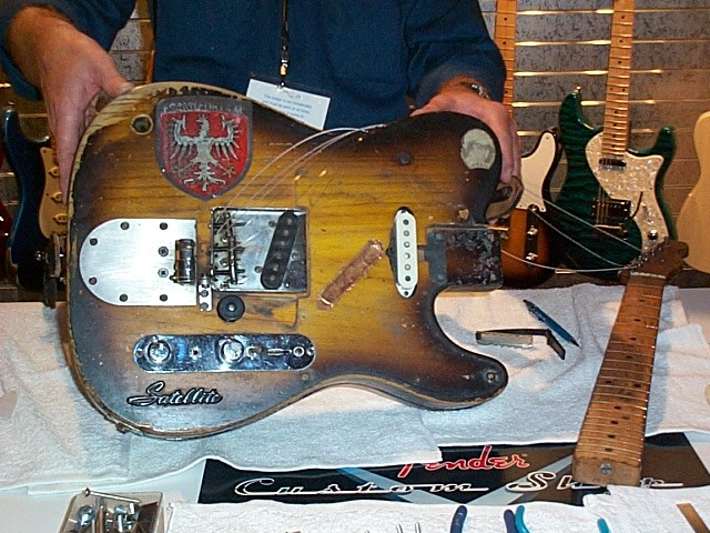A strat pickup (a 54 I believe) has been put in the neck position.