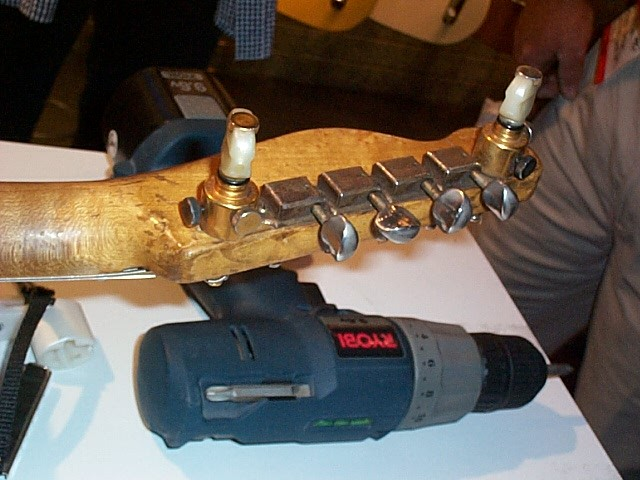 Banjo (Scruggs-Keith) tuners have replaced the two E string tuners.