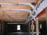 Heating and air ductwork spans the garage