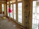Heather admires her new rear porch doors
