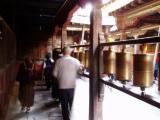 Devotees spinning the prayer wheels.