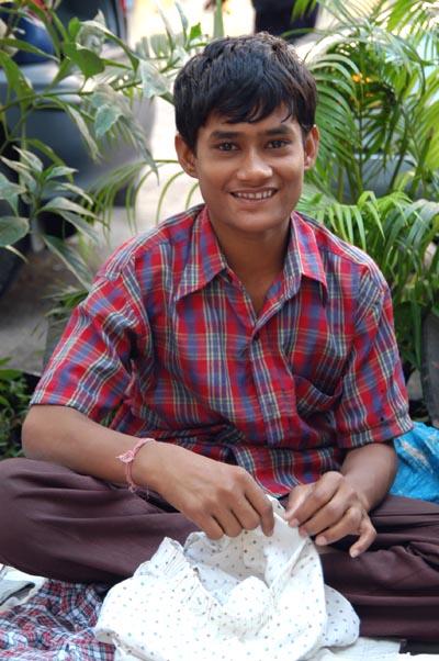 Boy selling shorts, Mumbai, India