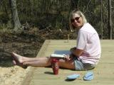 Heather enjoys an iced tea and a good book on the rear deck