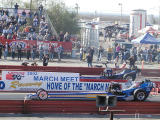 Top fuel dragsters staged
