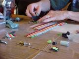 Susan building the scrap cane feather