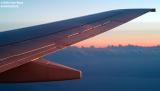 2002 - wing of Continental Airlines B737-824 at sunrise over South Florida aviation stock photo