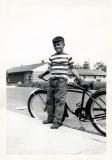 Richard leaning on bicycle, 1950 (402)