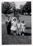 Mary's First Communion with John, Mike and Mary Claire.  Maple tree in background, 1956 (441)