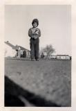 John posing in the street, 1952 (393f)