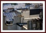 ...over Paris rooftops