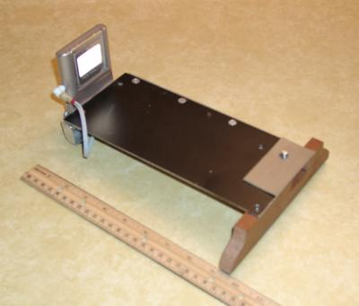 Modification Pic. 1.  Angle aluminum stiffener placed on right side and external battery pack for the film viewer.