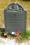 The grave of actor John Belushi. Rumor is that his body is actually buried in a grave elsewhere in the cemetery in an unmarked crypt.