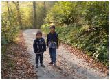 Cute active children enjoy running down the hill slope