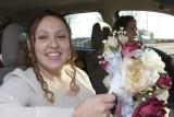 Bridesmaid in car
