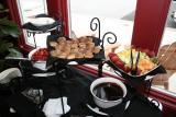 Dessert station with mini chocolate tartlets,