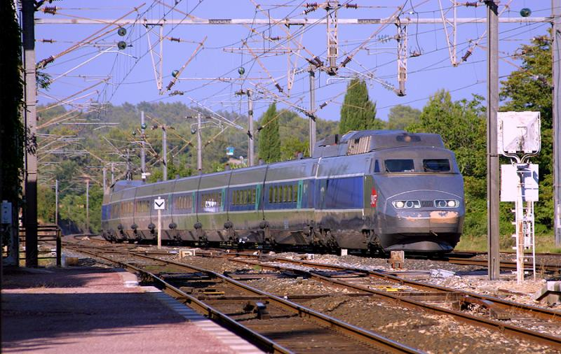 A TGV Sud-Est crossing the station of Carnoules.