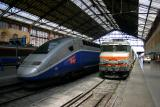 A TGV Duplex and a BB7200 at Marseille St-Charles.