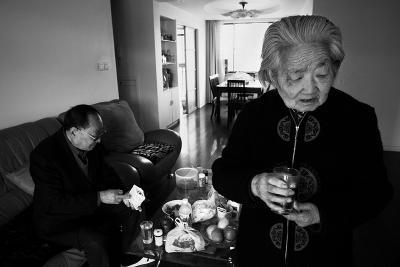 Taking Morning Pills, Shanghai, China, 2005