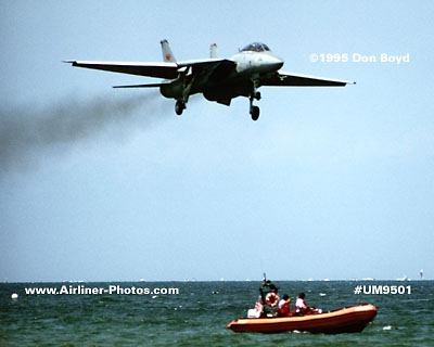 1995 - USN F-14 Tomcat and USCG crew and boat aviation stock photo #UM9501