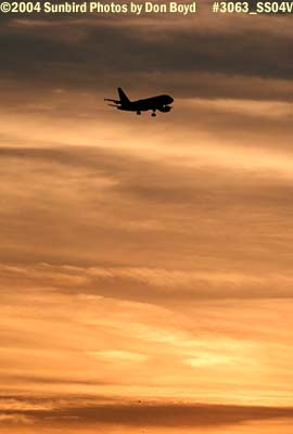 Frontier Airlines A319 on approach at sunset aviation airline stock photo #3063