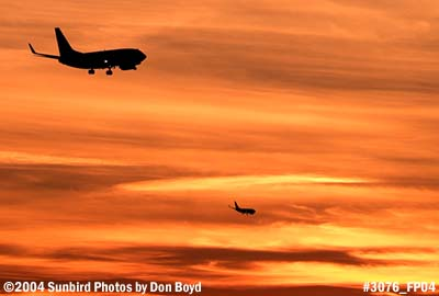 Fantasy photo of 2 B737-700s on approach at sunset stock photo #3076