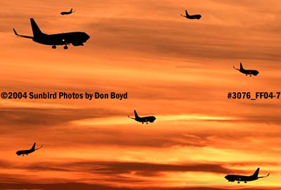 Fantasy photo of 7 B737-700s on approach at sunset stock photo #3076