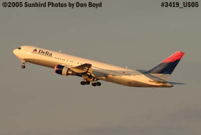 Delta Airlines B767-332/ER N178DZ takeoff on runway 30 at sunset aviation airline stock photo #3419