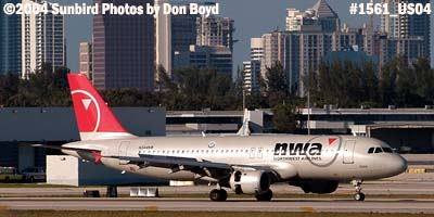 Northwest Airlines A320-212 N344NW with downtown Ft. Lauderdale in the background aviation airline stock photo #1561