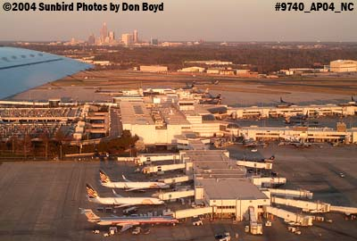 Charlotte Douglas International Airport at sunset with downtown Charlotte in the background aviation stock photo #9702